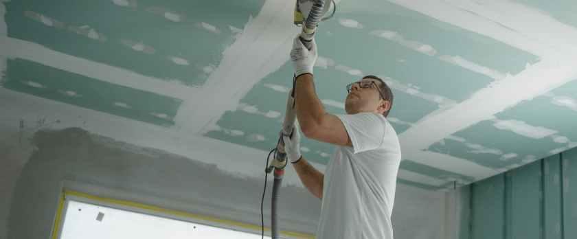 man polishing the ceiling
