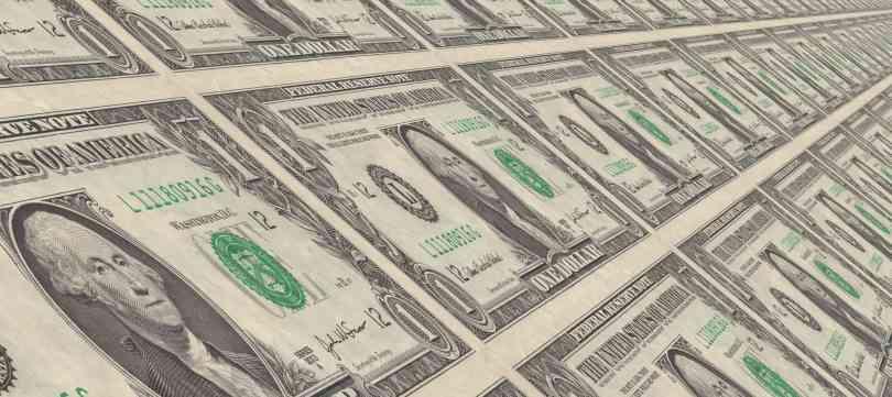 Foto ilustrando notas de 1 dólar.
