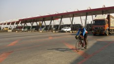 Some pose with bike, ahead of Nashik.