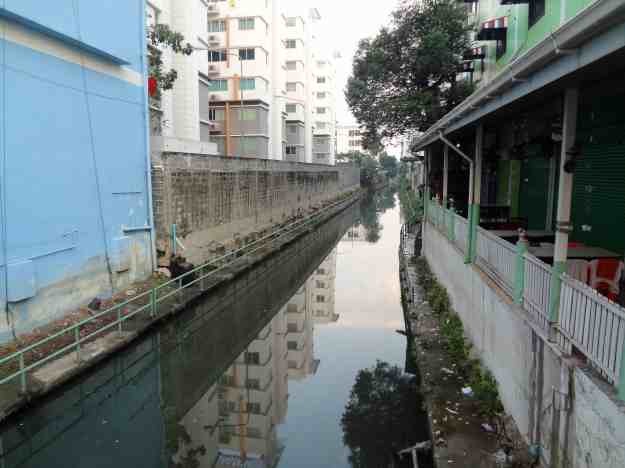 The scummy and rancid canal I walk over at least twice per day.  It always seems to be flowing toward the Chao Phraya River in the morning and away from it at night.