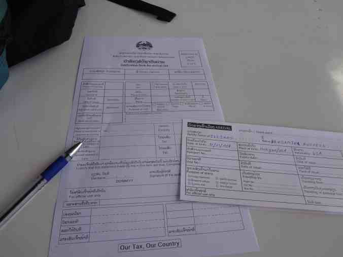 The paperwork for a Laos visa.