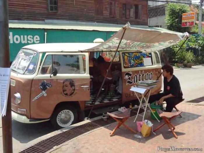 A van tattoo parlor near the park.