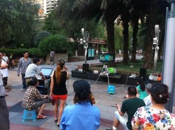 Outdoor karaoke at Jialing Park in Chongqing, China.