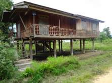 One of the old-style teak houses .
