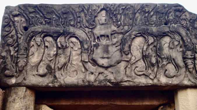 Lintel carving atop the entrance depicting Shiva and Nandi.