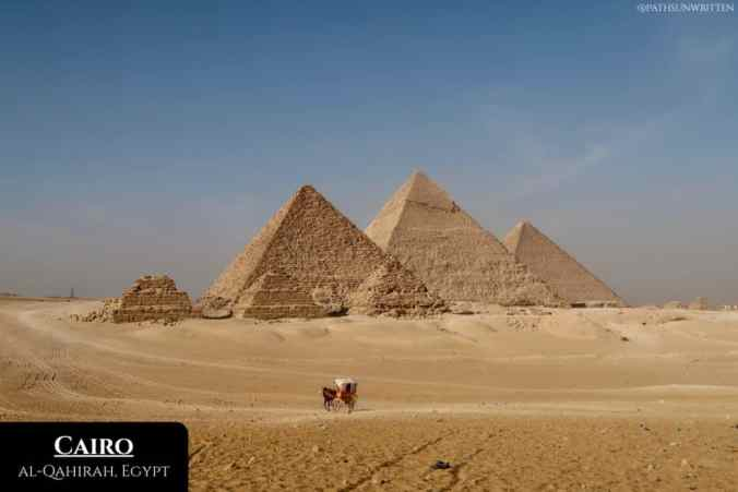 The Pyramids of Giza located at the western fringes of Cairo's urban sprawl.