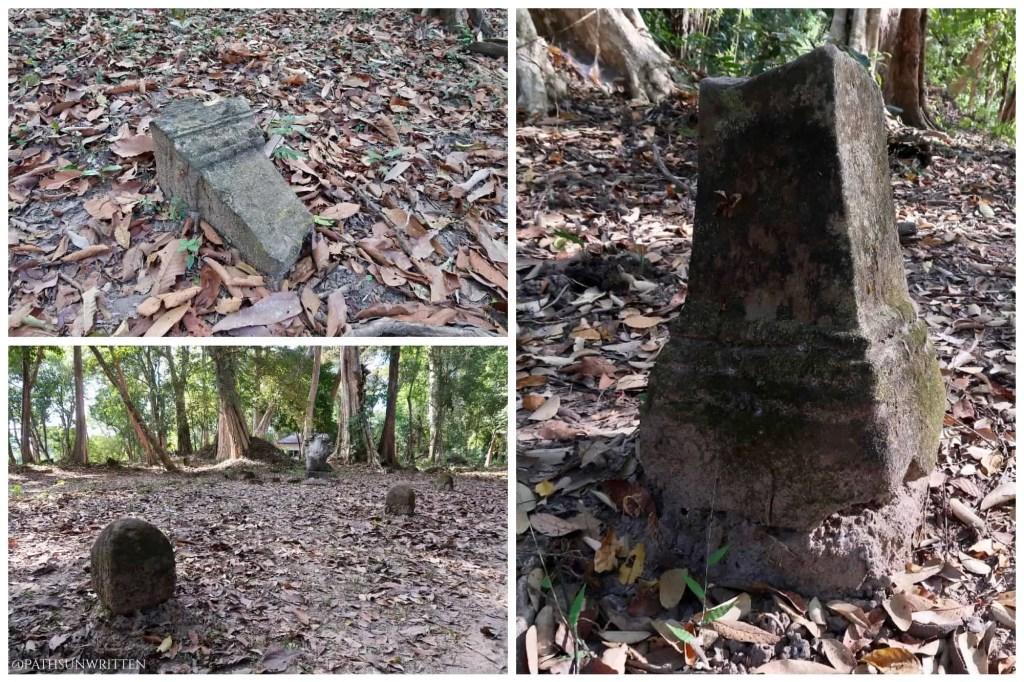 Broken ceremonial marker stones lead the path to Vat Tomo.