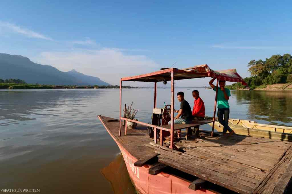 The Mekong ferries are two or more boats connected by wooden platform and can carry anything from a motorbike to a minibus.