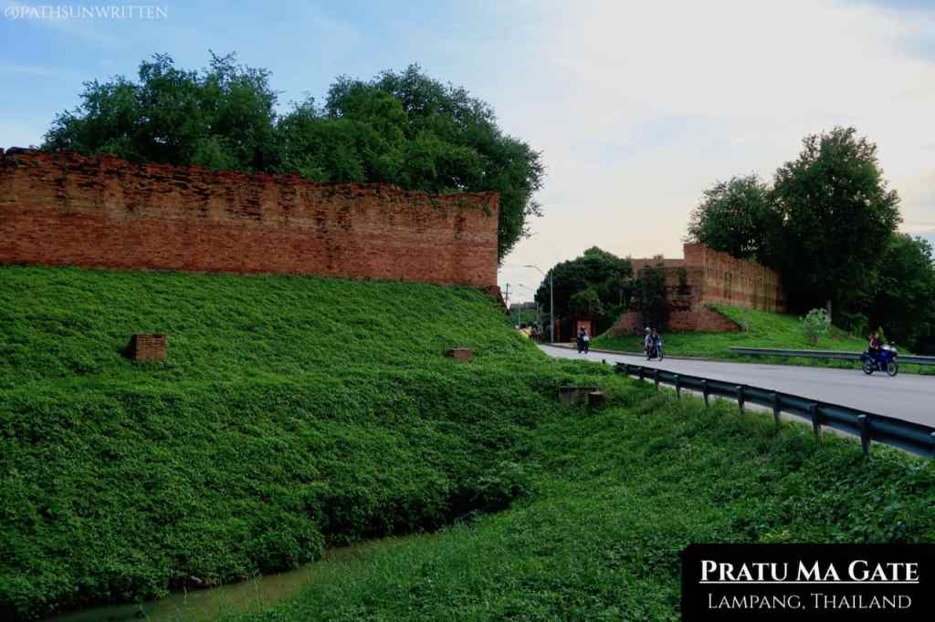The Pratu Ma gate and city moat from outside the city wall.