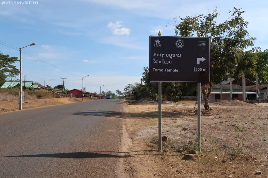 The sign before you turn onto the dirt road back to the Mekong River.