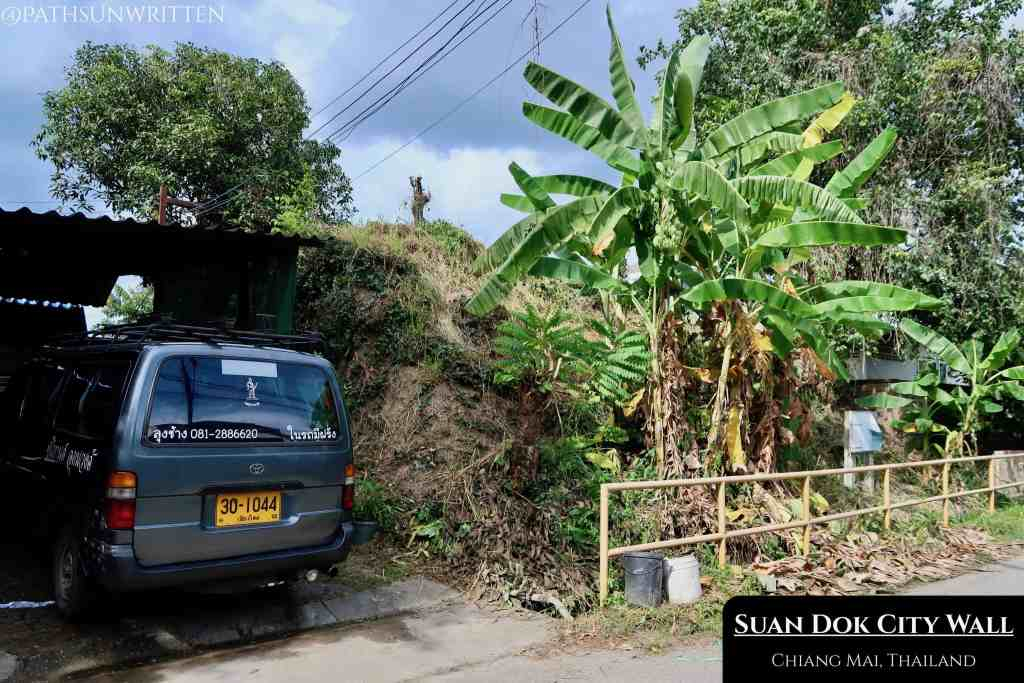 Sections of Wiang Suan Dok's southern wall have been torn down by private residences.