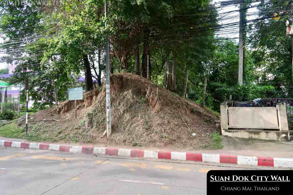 Wiang Suan Dok's western wall is bisected by Suthep Road.