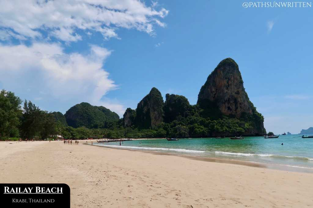 Railay's white sand beach is surrounded on all sides by limestone cliffs.