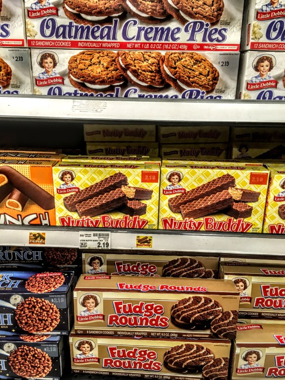 A store shelf displaying Little Debbie Nutty Buddy snacks.