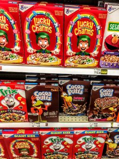 A store shelf displaying boxes of cereals, including Cocoa Puffs.