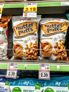 Bags of nutter puffs on a store shelf.