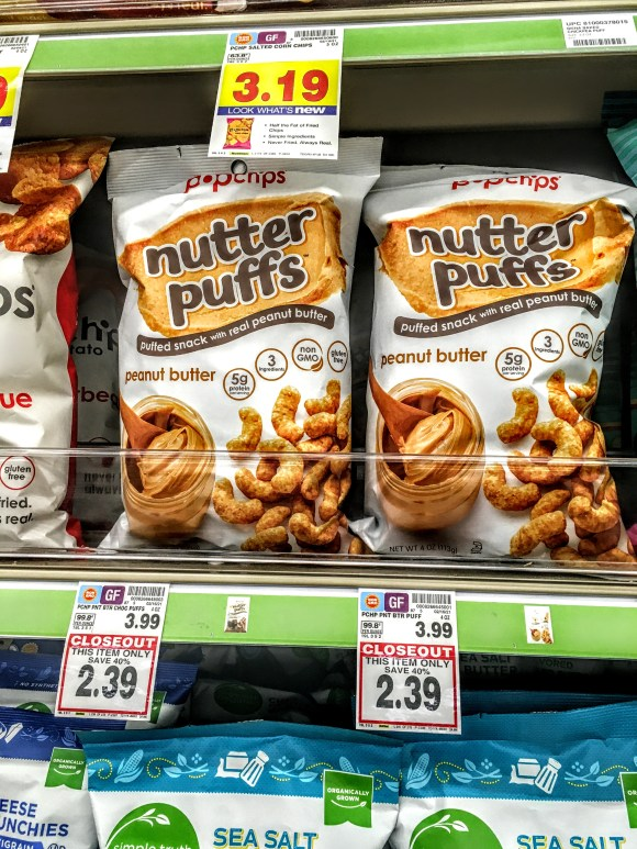 A store shelf displaying bags of Nutter Puffs