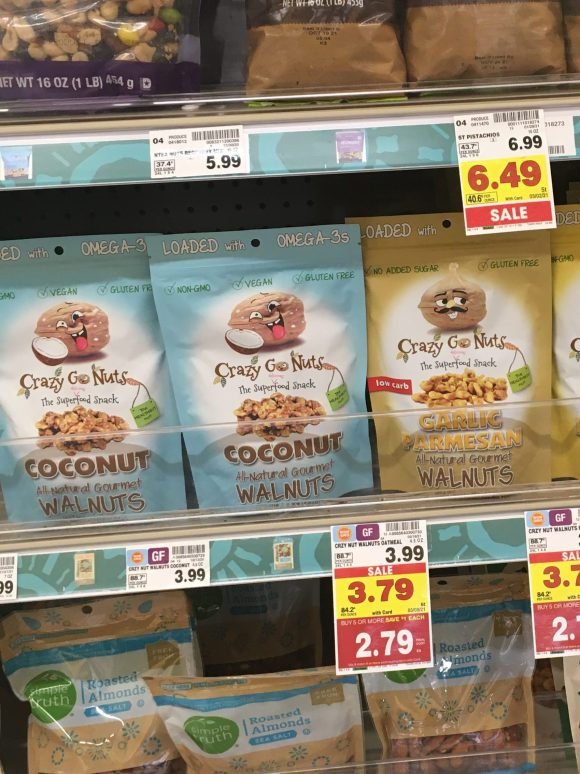 A store shelf displaying bags of Crazy Go Nuts walnuts.