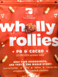 Close up of a bag of Crazy Richard's Wholly Rolly's peanut butter balls. There is an image of an elephant in the top center of the bag.