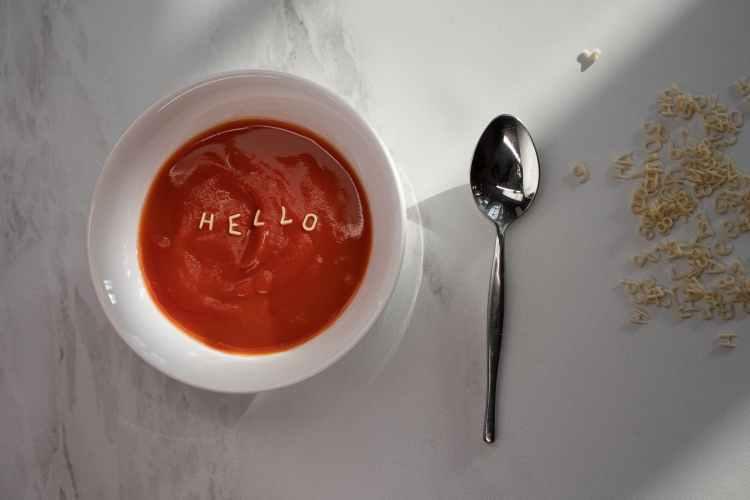 red sauce in white ceramic bowl