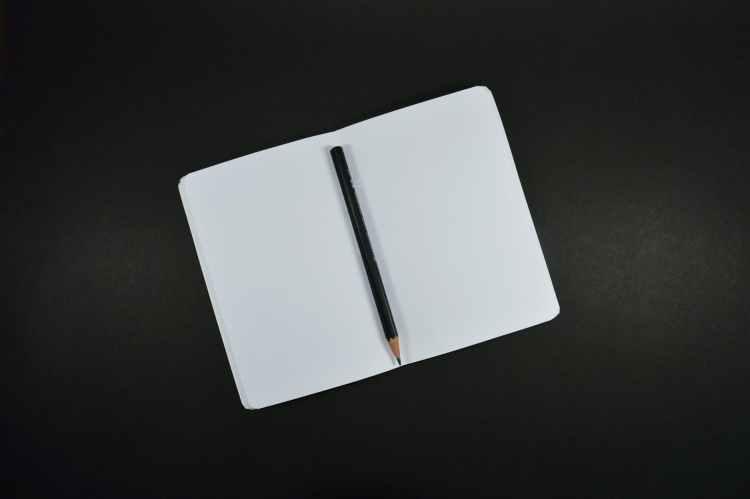 black pencil on white paper