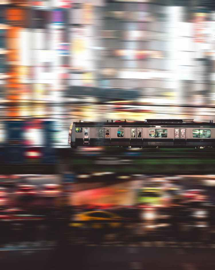 time lapse photography of people inside white and black train