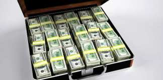 Pile of money in a suitcase