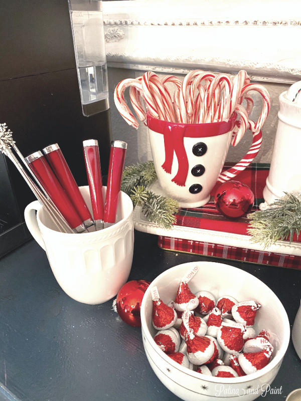 candy canes, mugs, spoons