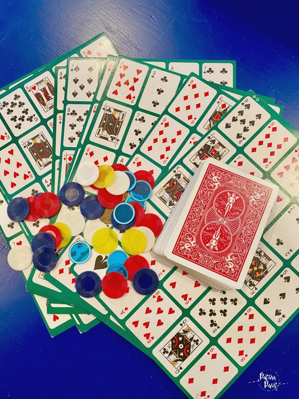 pokeno game card, playing cards and chips