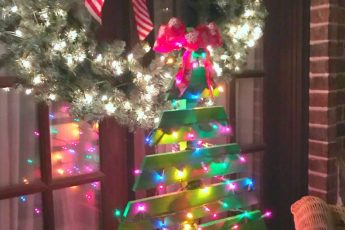Wooden Christmas tree on porch