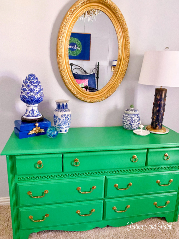 Green dresser, gold mirror, navy accessories