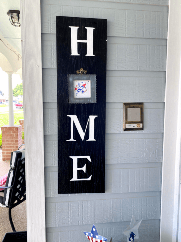 Patriotic charm on home sign