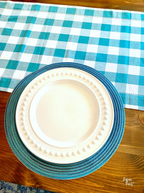 white dish, blue placemat