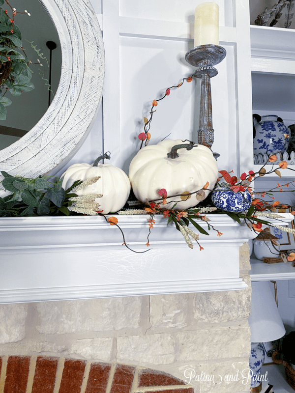 white pumpkins with greenery
