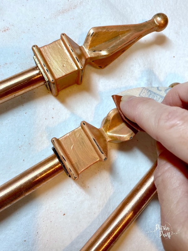 sanding copper finial on garden hose guide