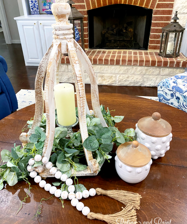 white lantern with candle and jars