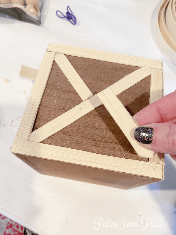 adding wood strips to a box