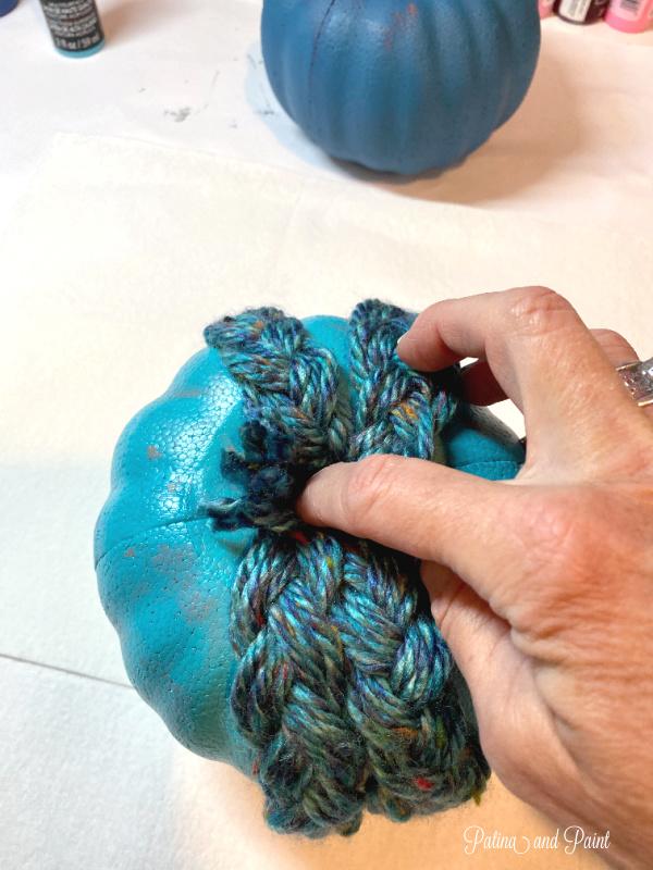 wrapping yarn around pumpkin
