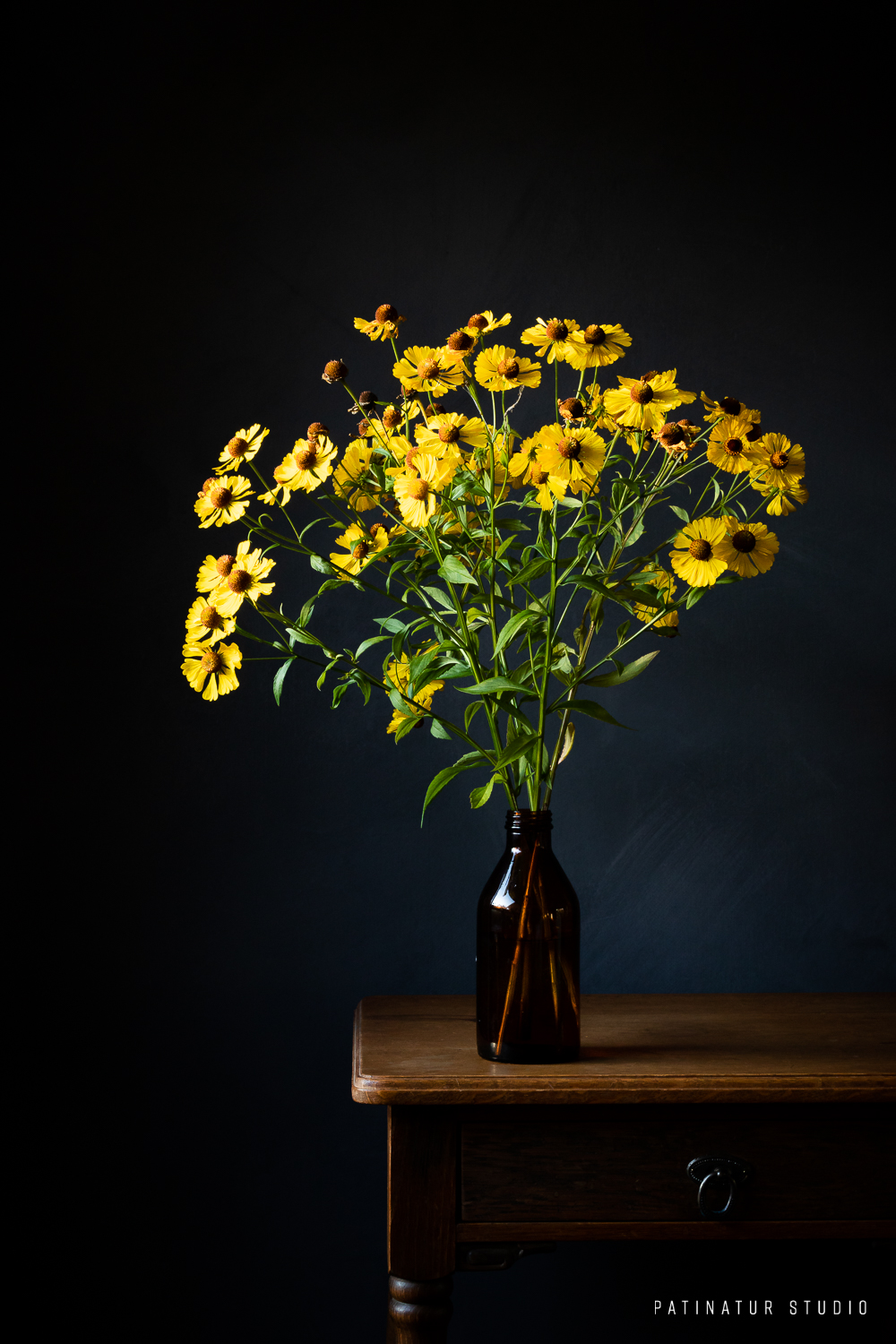 Photo art | Dark and moody still life with yellow Sneezeweed bouquet in brown glass bottle