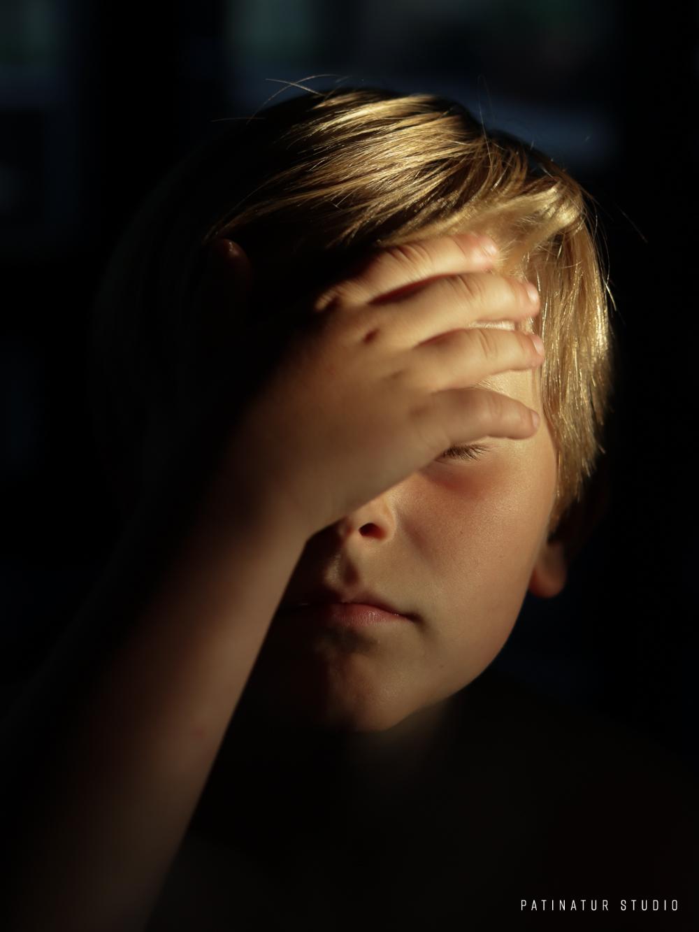 Chiaroscuro portrait of boy