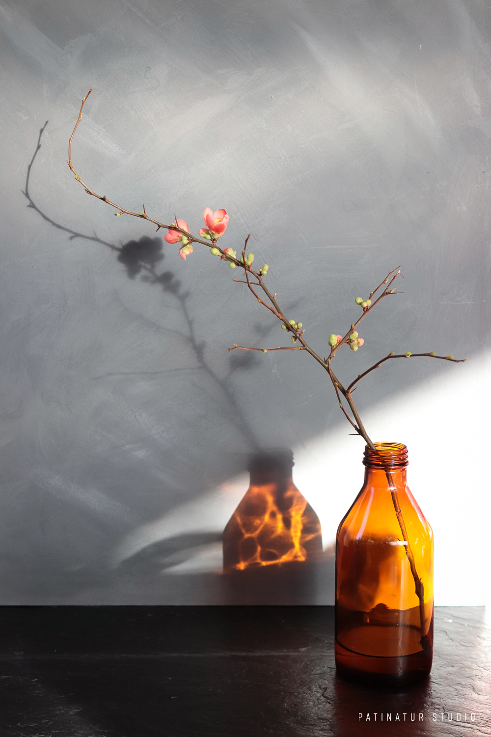Photo Art | Still life with quince blossom in amber glass bottle