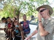 Sharing a joke with local lads at the south coast town of Suai.