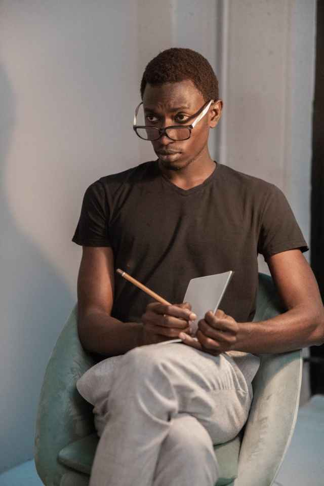 serious black man with notebook