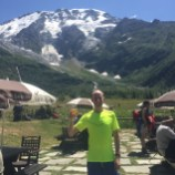 John enjoying a frosty beverage at Les Chalets du Miage.
