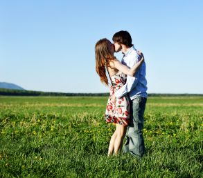 Couple in a Meadow Kissing