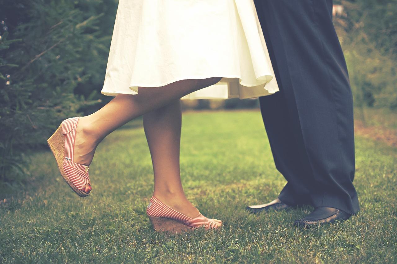 feet of couple outdoors dancing