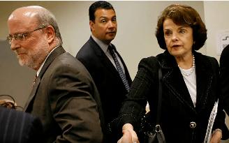 U.S. Senator Dianne Feinstein shaking hands before meeting. Alex Padilla in background.