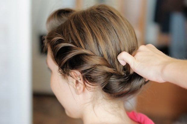 Young beautiful woman getting her hair done