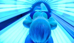 beautiful young woman at spa and wellness back massage treatment