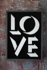 Love ought never be negative - against old mill wall